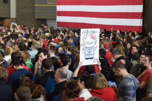 Poster of Hello Bernie in the crowd during rally. Photo Credit Kai Brito.