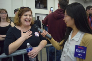 SUM News Director Kelly Wang interview Bernie Sanders' supporter after rally in Madison, WI. Photo Credit Kai Brito